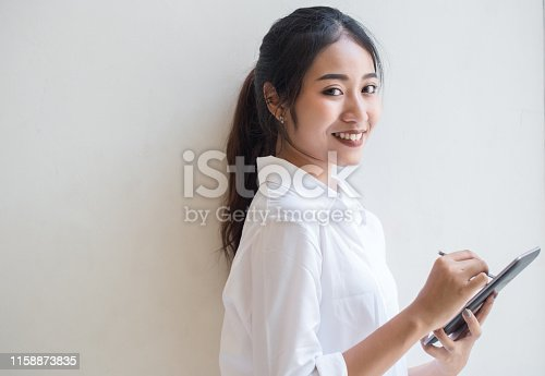 Young Asian business women working with digital tablet at home