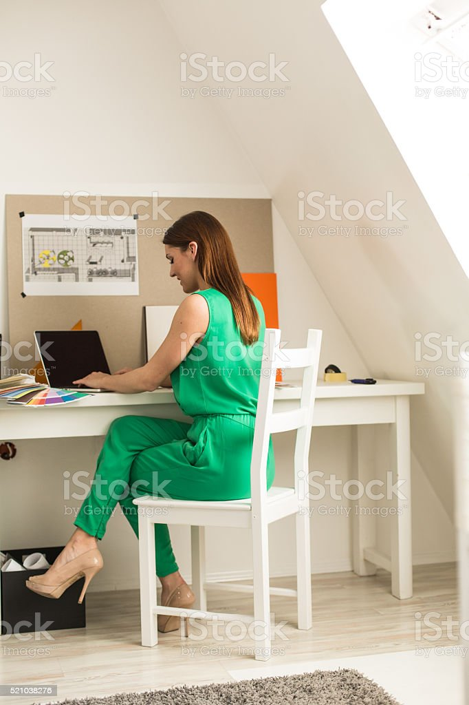 Freelance Interior Designer Working At Laptop Royalty Free Stock Photo