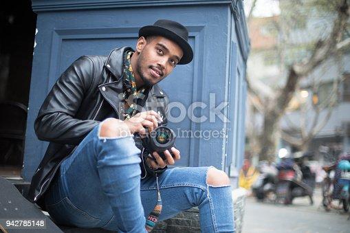 Freelance photographer walking around city.