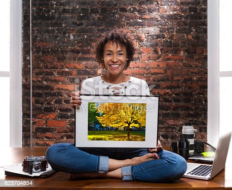 Young african American woman freelance photographer portrait.