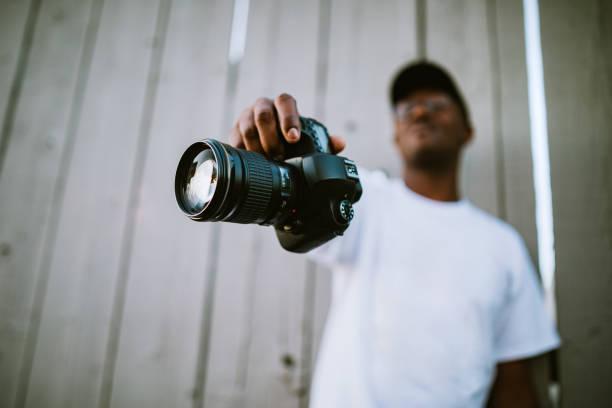 Freelance photographer showing off camera picture id1180506780?b=1&k=6&m=1180506780&s=612x612&w=0&h=l4ie7z2dsvy4zvmwn14en 77hkqz88rgng3rg0o4imo=
