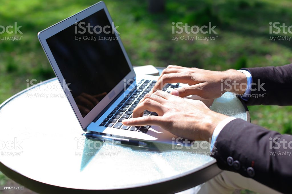 Freelancer doing online work on laptop stock photo