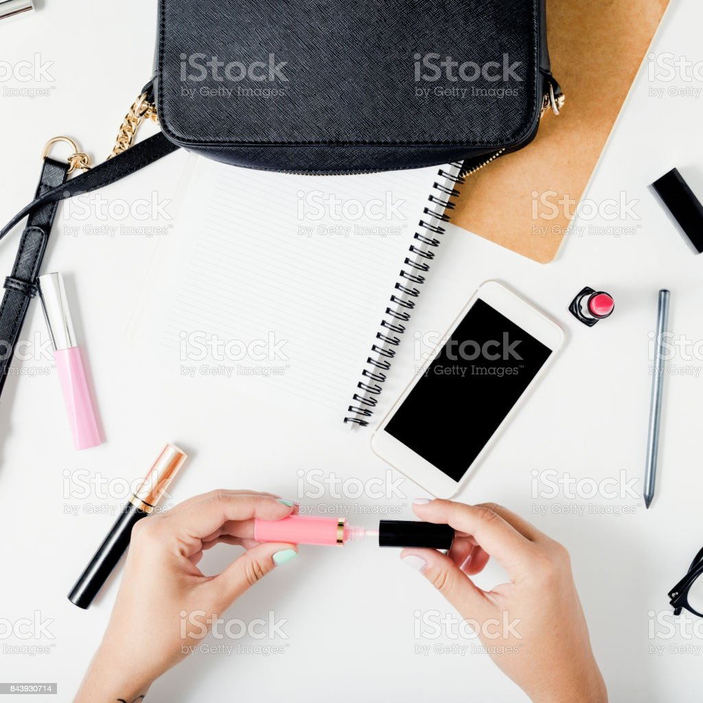 Freelancer feminine workspace in flat lay style with female accessories stock photo