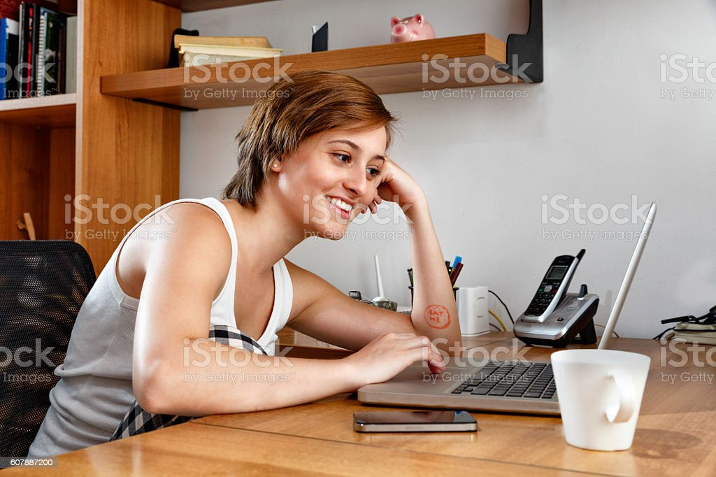 Freelancer gender fluidIty young woman working in home studio. stock photo
