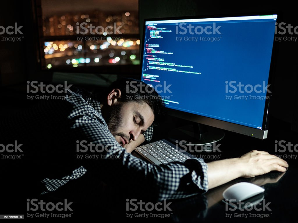 Freelancer programmer falling his face down taking a nap stock photo