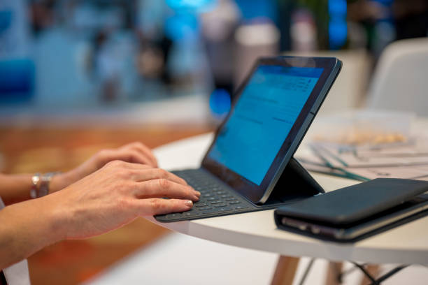 Freelancer typing on digital tablet stock photo