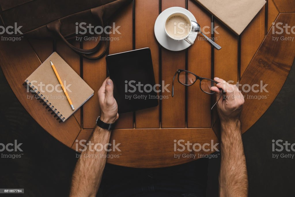 freelancer using digital tablet stock photo