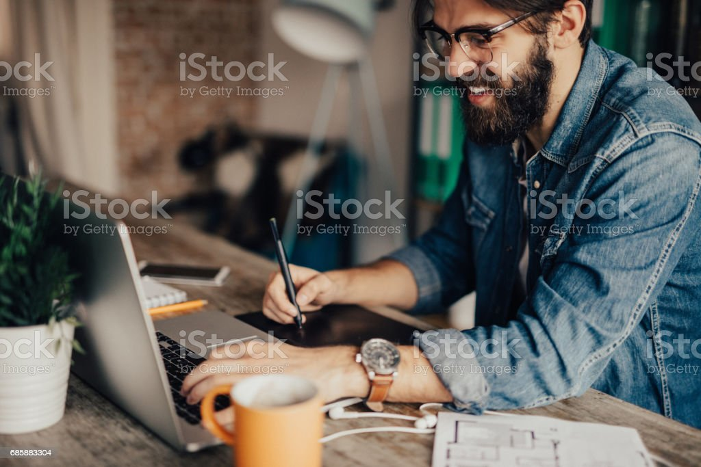 Freelancer working at his home office stock photo