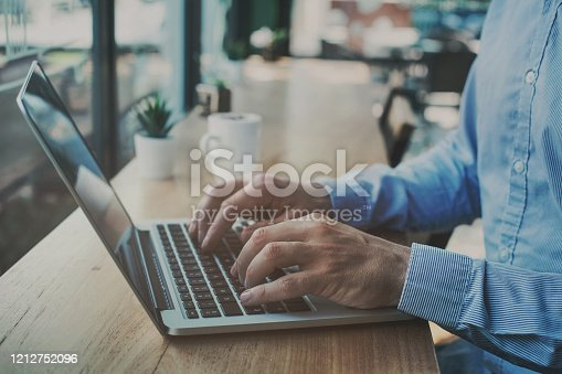 istock freelancer working on computer in cafe, freelance job online 1212752096