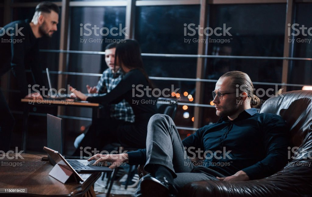 Freelancers on the job. Team of young business people works on their...