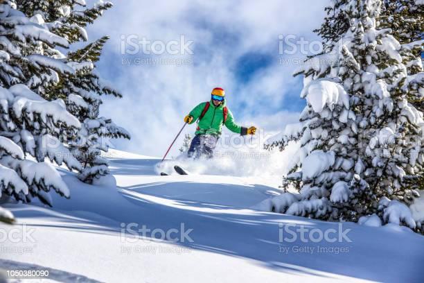 Freeride skier charging down through the forest in fresh powder picture id1050380090?b=1&k=6&m=1050380090&s=612x612&h=k4oo luktt hlrzcb5wc2 e hddakgaw930wwcm7j9a=