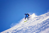 one adult skier on snowy slope, Passo Rolle, Italy