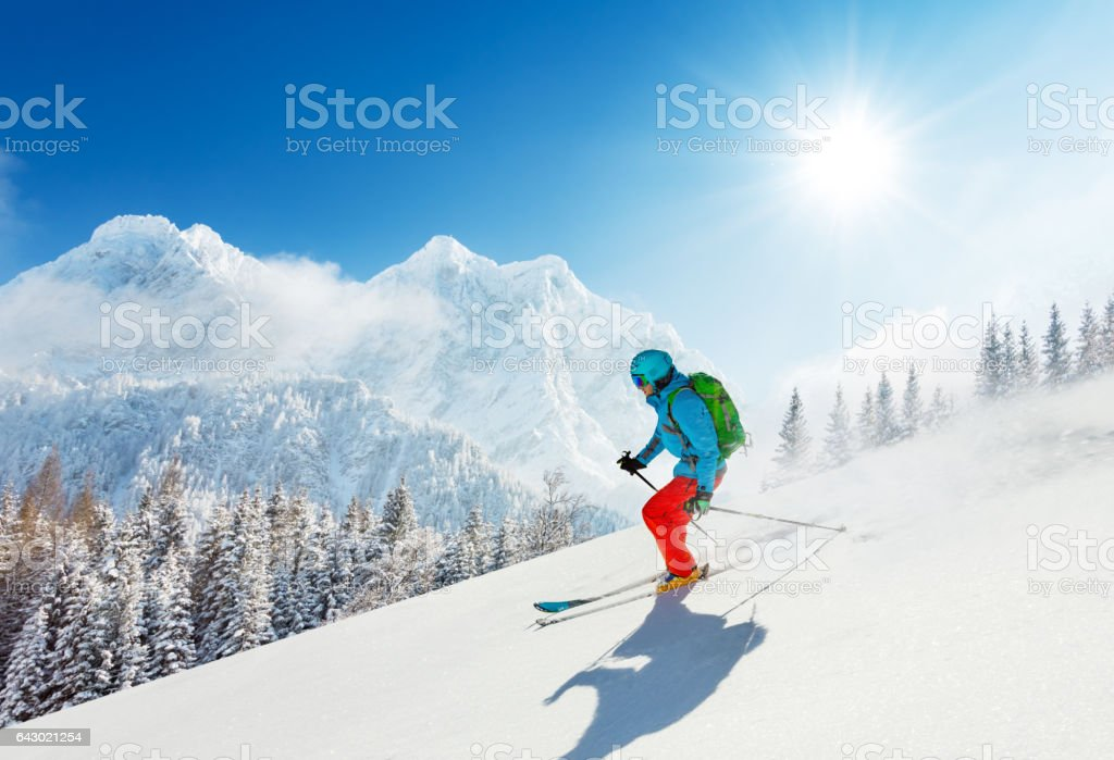 Free-ride skier in fresh powder snow running downhill stock photo