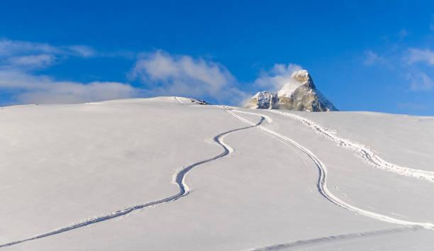 Freeride tracks on powder snow with mountain peak background picture id1167249051?b=1&k=6&m=1167249051&s=612x612&w=0&h=wocfyhwlolcmtgn0 pkbmlwdpn3nth1taxnurrsr82w=