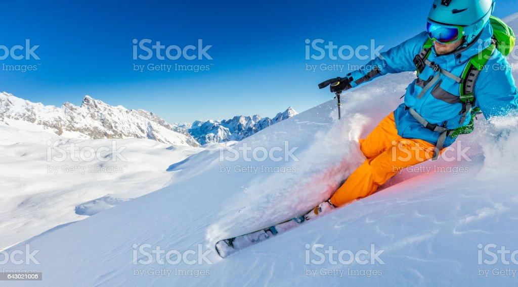 Freerider skier running downhill stock photo