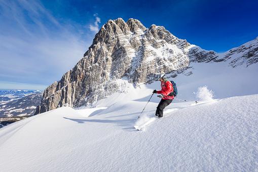 Freerider skier running downhill - Watzmann, Nationalpark Berchtesgaden in Alps