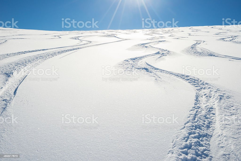 Freeriding on fresh snowy slope stock photo