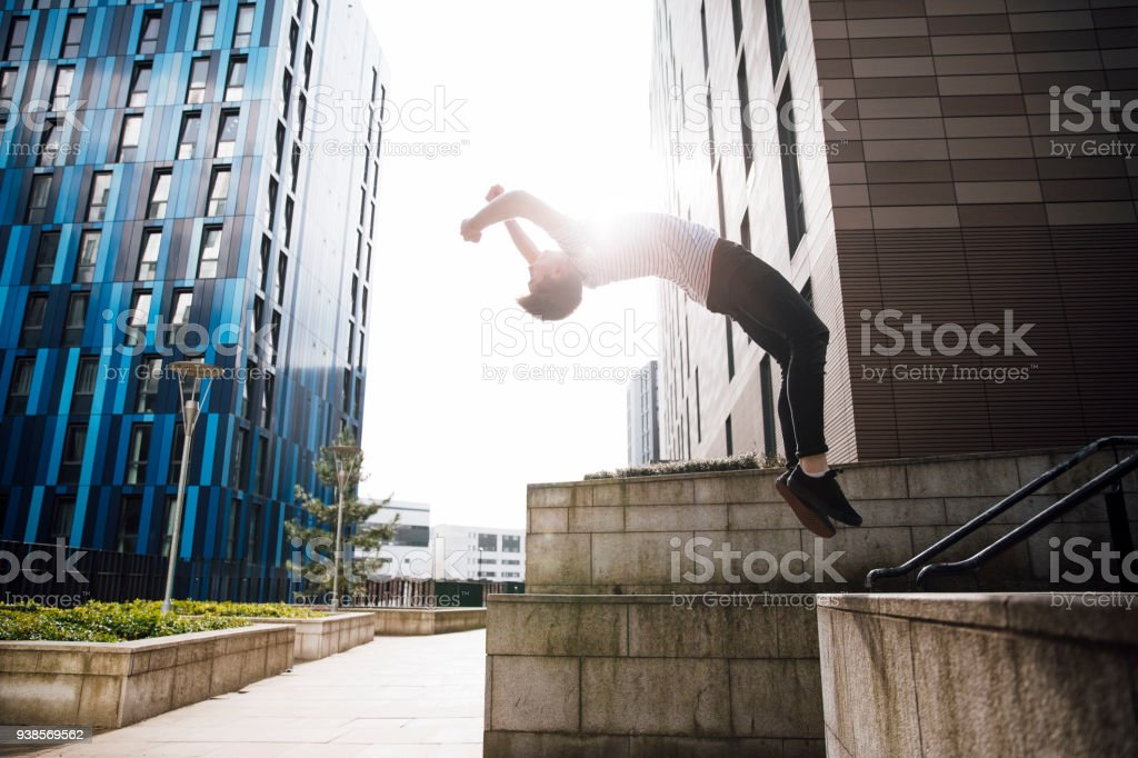 Freerunner doing a Backflip in the City stock photo