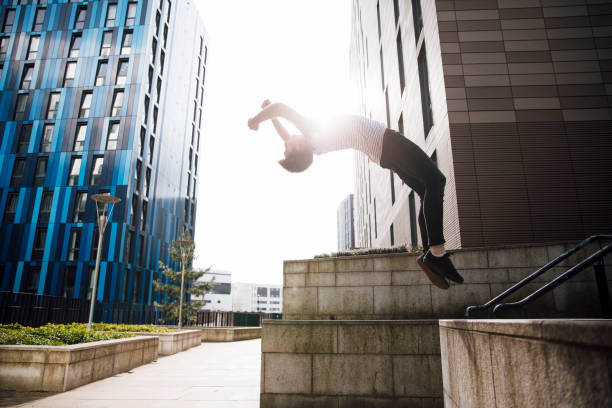 Freerunner doing a Backflip in the City stock photo