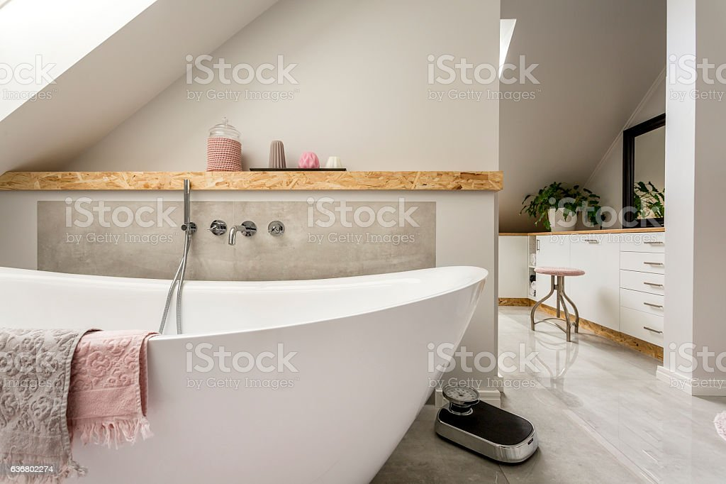 Freestanding bath in grey bathroom stock photo