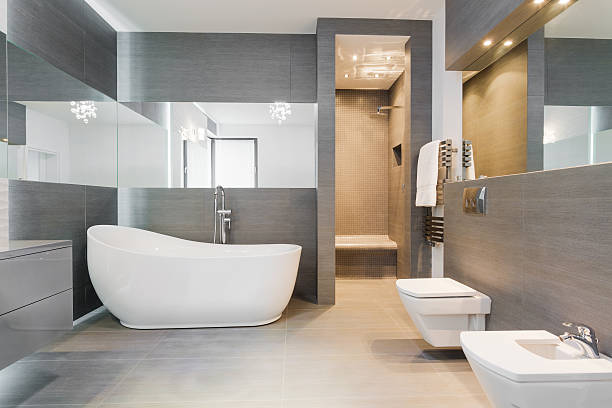 Freestanding bath in modern bathroom Designed freestanding bath in gray modern bathroom household fixture stock pictures, royalty-free photos & images