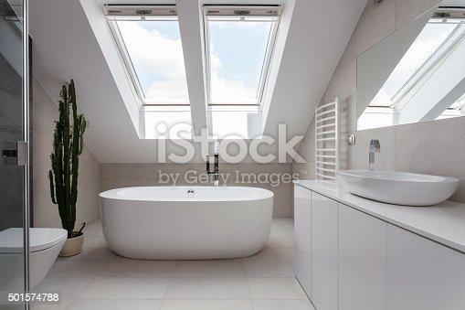 Porcelain freestanding bath in designed white bathroom