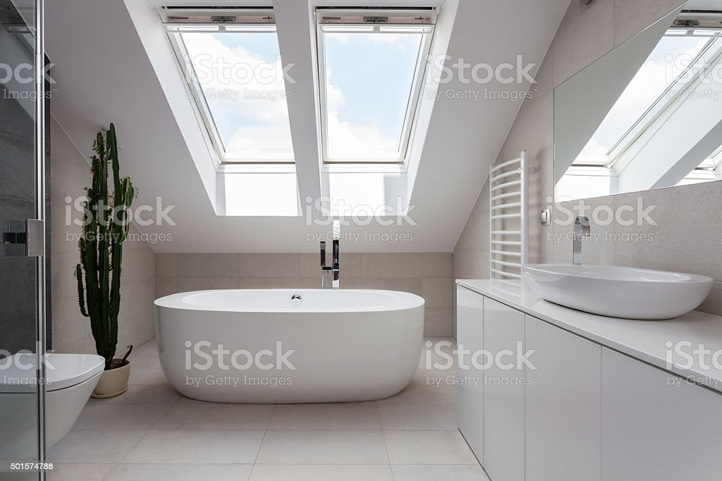 Freestanding bath in white bathroom stock photo