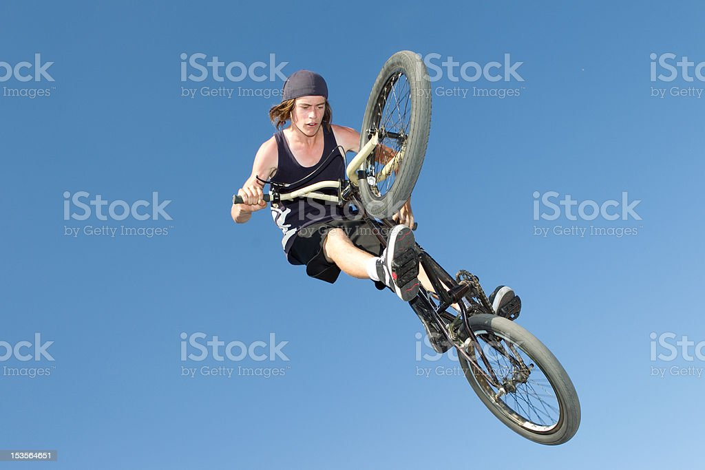 Freestyle BMX rider getting air stock photo
