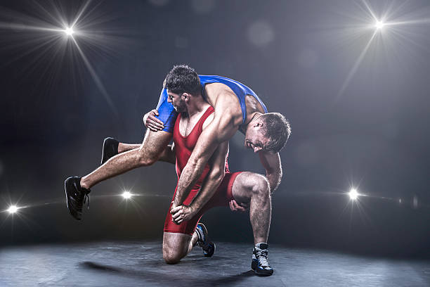 freestyle wrestler throwing - wrestling stock photos and pictures