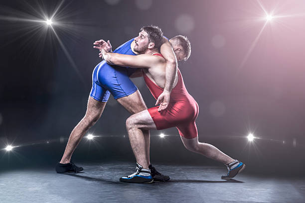 freestyle wrestlers in action - wrestling stock photos and pictures