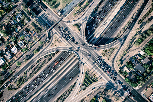 A busy freeway during rush hour in the city of Phoenix, Arizona shot from an altitude of about 1000 feet during a helicopter photo flight.
