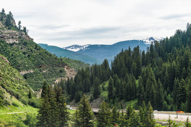 Freeway highway through Colorado towns near Avon Vail in rocky mountains Freeway highway through Colorado towns near Avon Vail in rocky mountains beaver creek colorado stock pictures, royalty-free photos & images