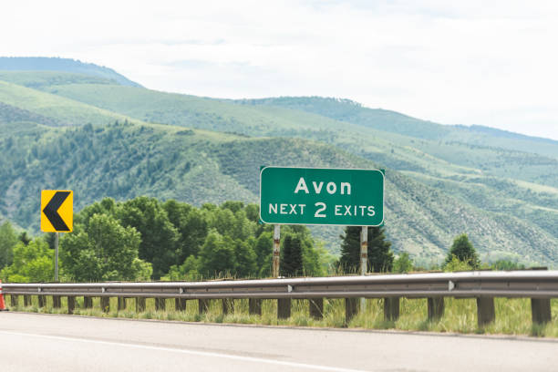 Freeway highway through Colorado towns with sign for Avon city in rocky mountains Freeway highway through Colorado towns with sign for Avon city in rocky mountains avon colorado stock pictures, royalty-free photos & images