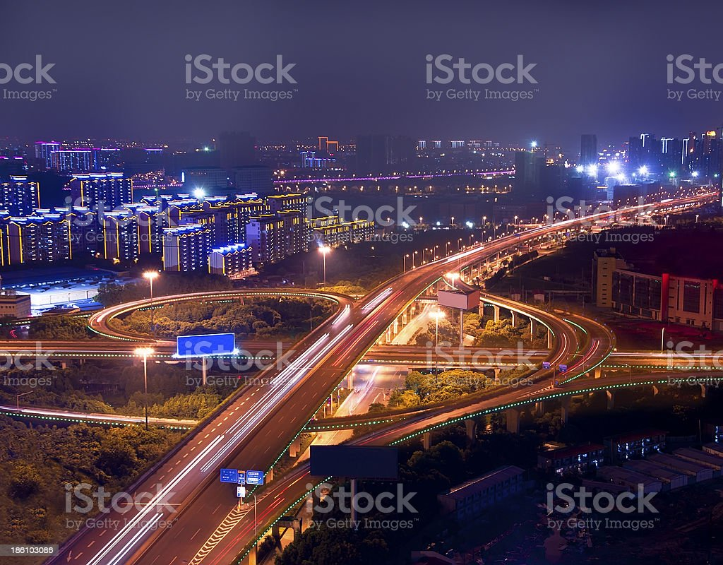 Freeway in night with cars light at modern city royalty-free stock photo