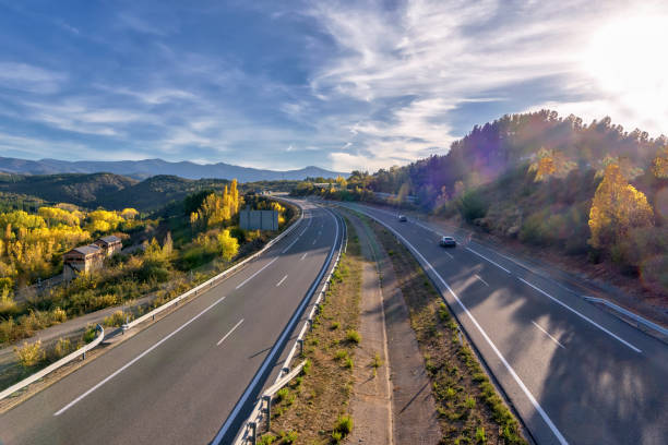 A-6 freeway in Spain, with fall foliage vegetation; high angle view A high angle view of A-6 freeway in Spain, also known as northwestern freeway, with fall foliage. multiple lane highway stock pictures, royalty-free photos & images