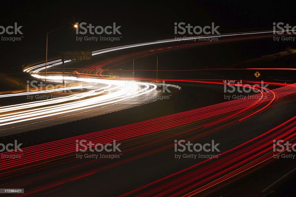 freeway lighttrails stock photo