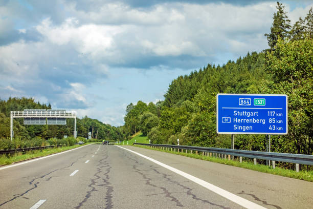 freeway road sign on Autobahn A81 motoway road sign on (Autobahn 81 / A 81 / E 531) showing way to city Stuttgart, Herrenberg and Singen singen stock pictures, royalty-free photos & images
