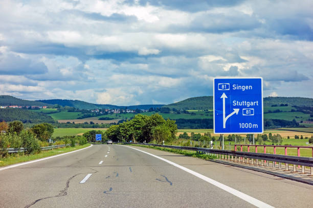 freeway road sign on Autobahn A81 showing exit to Stuttgart motoway road sign on (Autobahn 81 / A 81 / E 531) - exit to city Stuttgart - direction to city Singen singen stock pictures, royalty-free photos & images