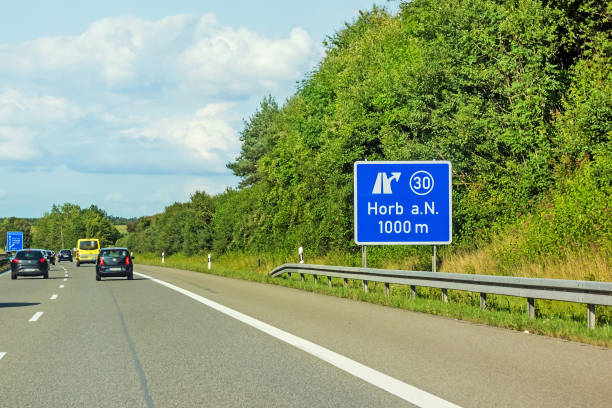 freeway road signs on Autobahn A81 showing exit to Horb am Neckar motoway road signs on (Autobahn 81 / A 81 / E 531) direction Stuttgart - exit to city Horb am Neckar singen stock pictures, royalty-free photos & images