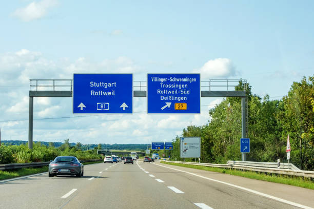 freeway road signs on Autobahn A81 showing exit to Villingen-Schwenningen motoway road signs on (Autobahn 81 / A 81 / E 531) direction Stuttgart / Rottweil - exit to Villingen-Schwenningen / Trossingen / Rottweil-Sud / Deisslingen (B27) singen stock pictures, royalty-free photos & images
