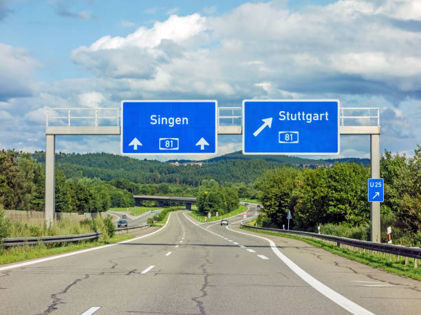 freeway road signs on Autobahn A81 showing exit to Stuttgart motoway road signs on (Autobahn 81 / A 81 / E 531) - exit to Stuttgart - direction to Singen singen stock pictures, royalty-free photos & images