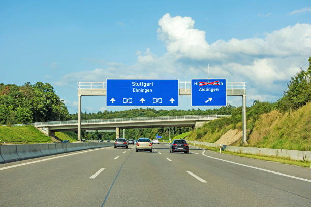 freeway road signs on Autobahn A81 showing Stuttgart / Ehningen motorway road signs on (Autobahn 81 / A 81 / E 531) direction Stuttgart / Ehningen - exit to Hildrizhausen (axed) and Aidlingen singen stock pictures, royalty-free photos & images