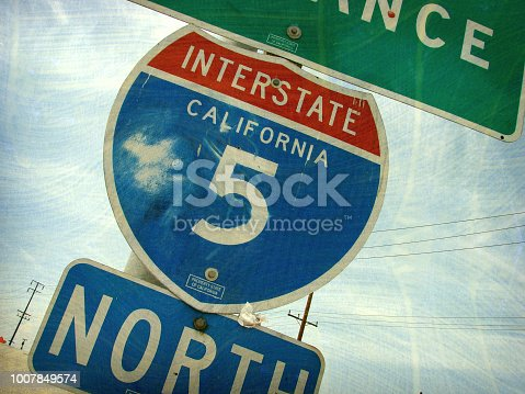aged and worn California freeway sign
