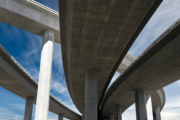 Freeway Span Elevated roadway with bright blue sky elevated road stock pictures, royalty-free photos & images