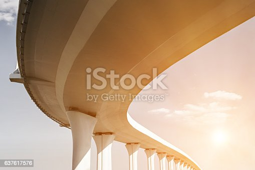 Underside of an elevated road with sun effect