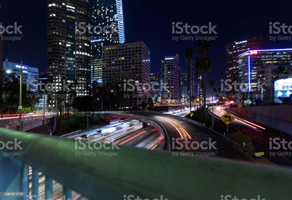 Freeway Traffic at Night in DTLA stock photo
