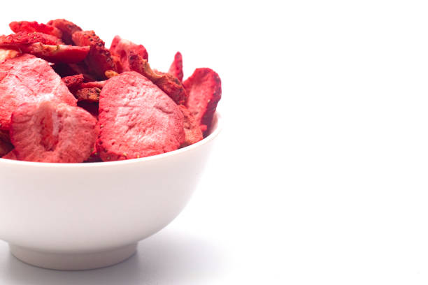 freeze dried strawberries on a white background - dried food stock photos and pictures