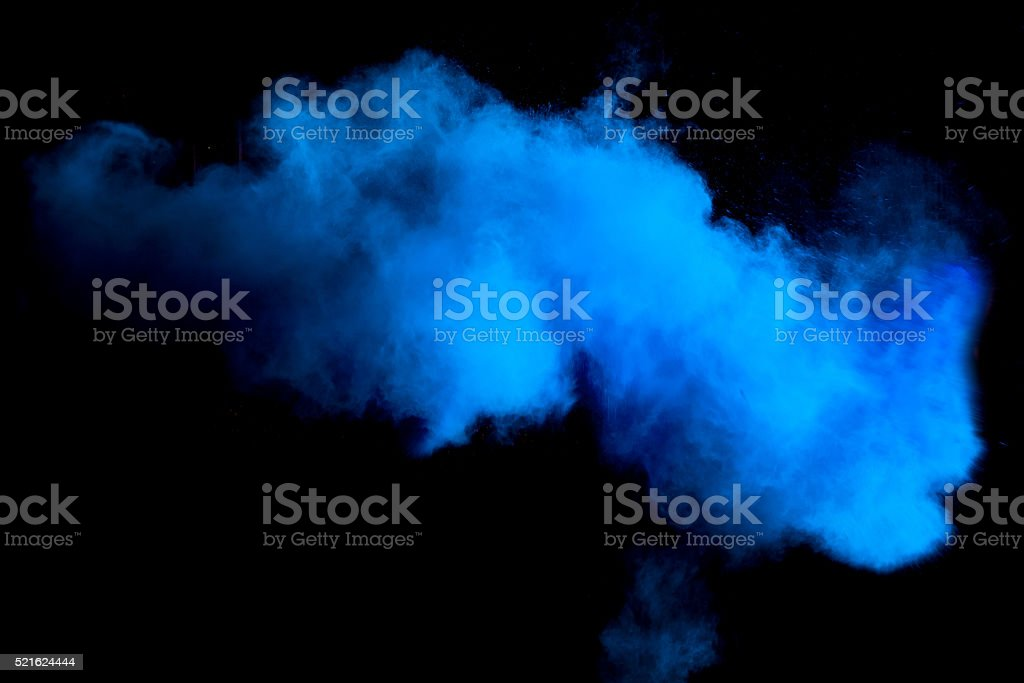 Freeze motion of blue dust explosion stock photo