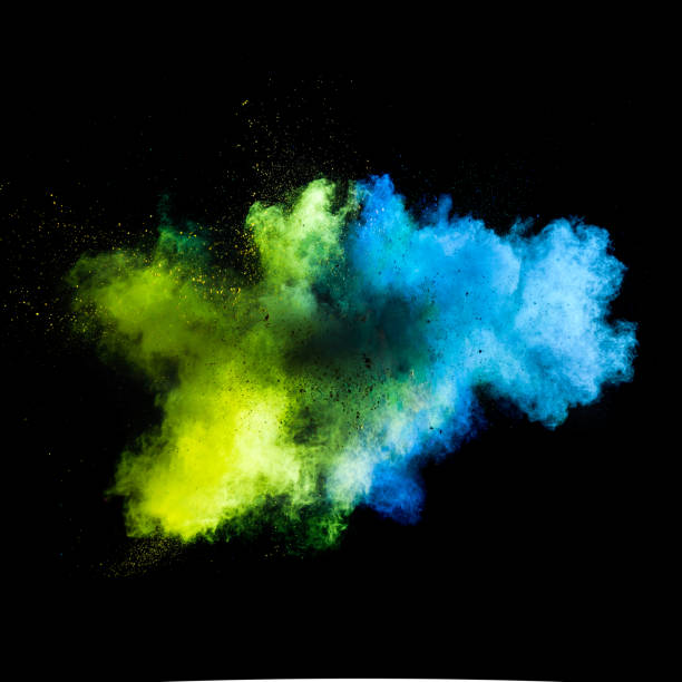 freeze motion of colored dust explosion - abstract multicolored powder explosion stock photos and pictures