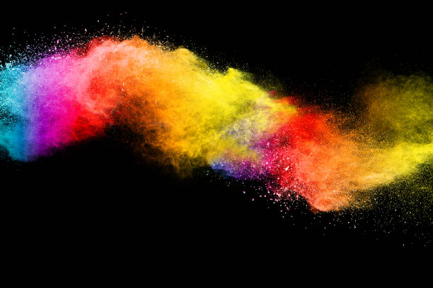 Freeze motion of colored powder explosions isolated on black background stock photo